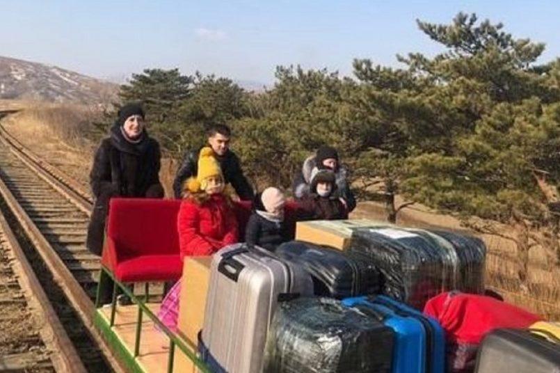 Russian envoys arrive home on rail trolley from N Korea